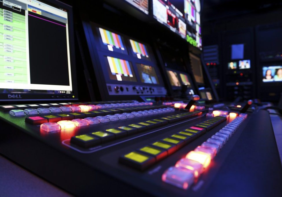 View of a TV production switcher in a broadcast television control room setting